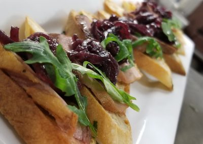 seared duck crostini with onion jam