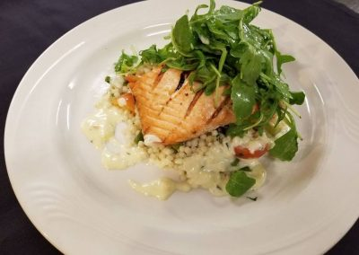 Faroe island salmon over couscous with a lemon beurre blanc